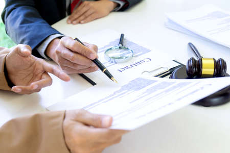 Businessman and businesswoman talk and consult about contract business paper serious consultations between attorneys and employers