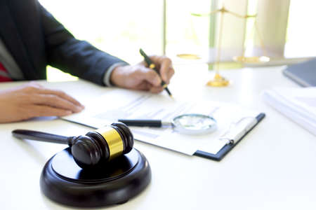 Lawyer or Judge work in the office  gavel and balance on the white table.