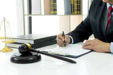 Lawyer or Judge work in the office gavel and balance on the white table. Stock Photo