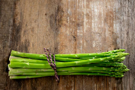 Group of Fresh asparagus on the wood background  raw vegetable food for health cook more copy space 版權商用圖片