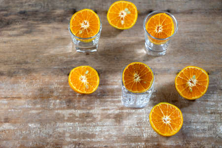Group of oranges cut in half in   glass cup on the old wood background Stock fotó