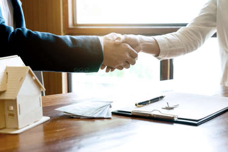 Real estate business the businessman had handshake after get after reaching an agreement Фото со стока