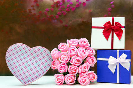 on white table group of gift box and heart shape  on the multi color background pink tone romantic vintage style.