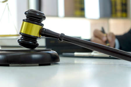 Closeup of wood gavel on the table it is the symbol of law justice on the legal