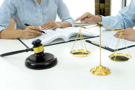 Lawyers and assistants are discussing legal matters to prepare business contracts and client solutions  gavel and balance in the law firm