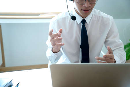 Business people are answering telephone conversations using a headset to provide details and answer customer questions call centre or telemarketing concept.