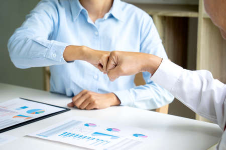 two business people use hand to fist bump for succes teamwork coporate Partner Business Trust Teamwork Partnership