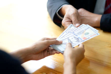Businessman or office receive cash money from another person or this banknote be salary income from their work or bribe