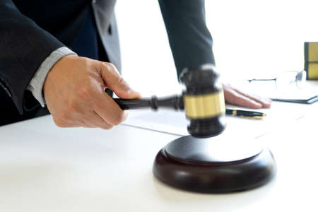 The judge was wave hammering his hand gavel move down to decide the case concept Law firm 版權商用圖片
