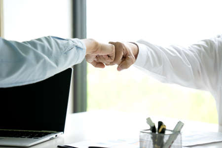 two business people use hand to fist bump for success teamwork corporate Partner Business Trust Teamwork Partnership