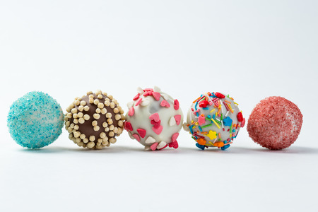 cake pops isolated lying on white table. beautiful cake pops isolated on white background.