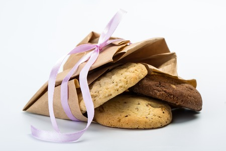 Delicious chocolate cookies in a paper package tied with a beautiful pink ribbon