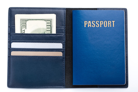 dark blue wallet with passport, money and cards. Stock Photo