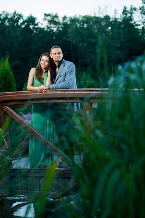Bride and groom near lake. Stock Photo