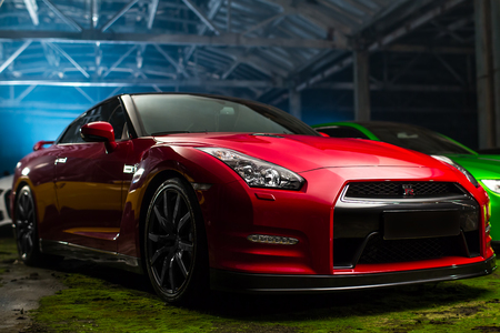 Kiev, Ukraine - 14 may 2014: Nissan gtr red sport car in old stock. 에디토리얼