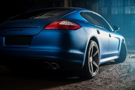 Kiev, Ukraine - 14 may 2014: Porsche Panamera blue in old factory. porsche panamera back view.