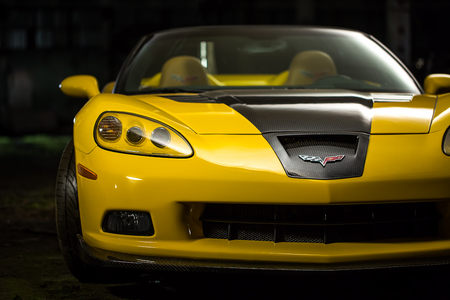 Kiev, Ukraine - 14 may 2014: Corvette yellow tuning in stock. Yellow designet corvette in old factory. Editorial