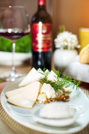 membrillo: cheese plate with nuts and herbs.