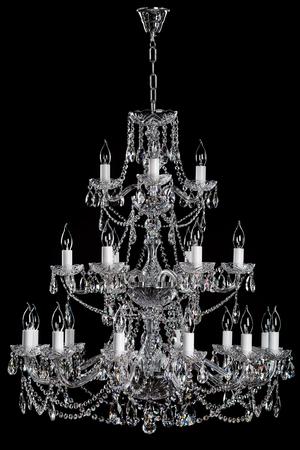 electric fixture: luxury chandelier on black background.