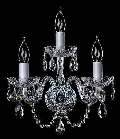 Magnificent chrome sconce on the dark background. Stock Photo