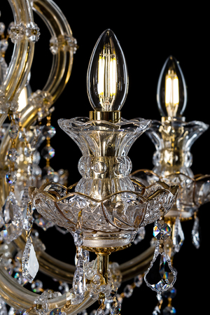 antique furniture: Contemporary glass chandelier isolated on black background. close-up chandelier.