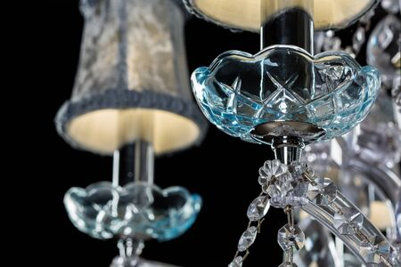 Chrystal chandelier close-up. On black background with copy space Stock Photo