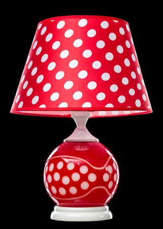 antique furniture: modern table lamp isolated on black.