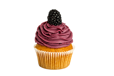 mulberry sweet cupcake with a berry on the top on a white background.