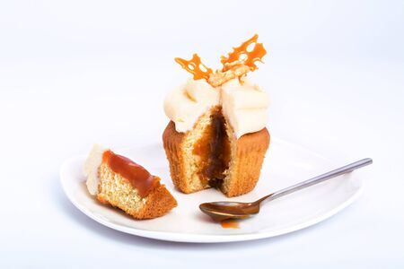 chantilly: Caramel sweet cupcake cut on a white background.