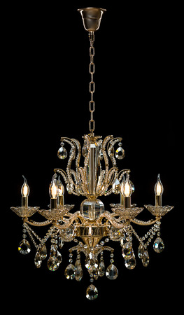 Contemporary glass chandelier isolated on black background.