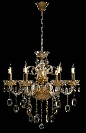 antique furniture: Contemporary glass chandelier isolated on black background.