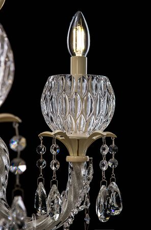 antique furniture: Contemporary glass crystal chandelier isolated on black background. close-up chandelier.