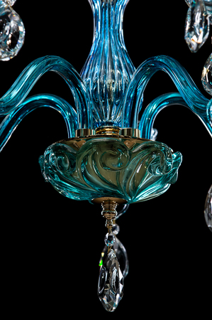 Contemporary blue glass crystal chandelier isolated on black background. close-up chandelier.