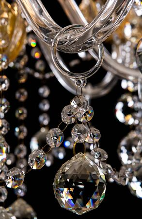 antique furniture: Contemporary gold chandelier isolated on black background. close-up . Crystal chandelier Stock Photo