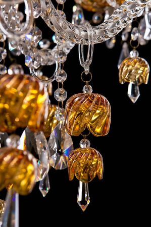 Contemporary gold chandelier isolated on black background. close-up . Crystal chandelier Stock Photo