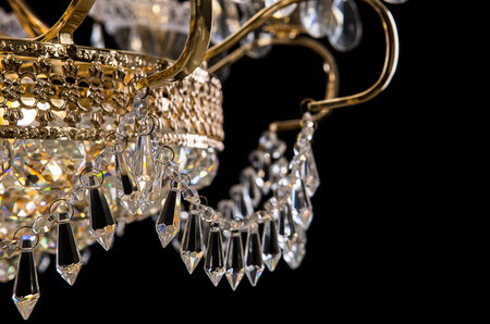 Contemporary gold chandelier isolated on black background close up contemporary gold chandelier isolated on black background close up crystal chandelier stock photo aloadofball Image collections