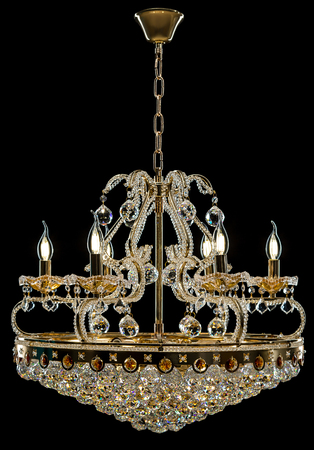 Contemporary gold chandelier isolated on black background. Crystal chandelier Stock Photo