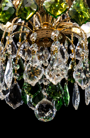 Large crystal chandelier close up with green crystals isolated 79017102 chandelier for interior of the living room chandelier details decorated green crystals isolated on black background aloadofball Images