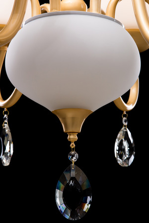 Chandelier for interior of the living room. White Chandelier close-up photo isolated on black background.