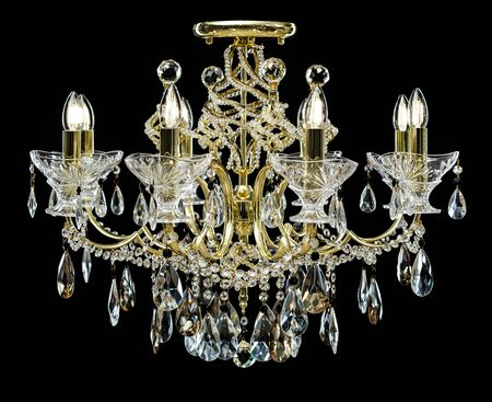 Chandelier for interior of the living room. chandelier decorated with crystals isolated on black background. Stock Photo