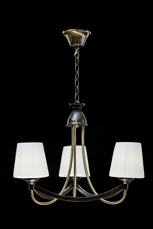 Chandelier for interior of the living room. White Chandelier isolated on black background. Stock Photo