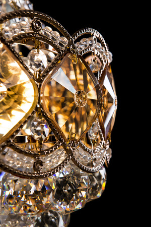 vintage furniture: Large crystal chandelier close-up in baroque style isolated on black background. Luxury royal expensive chandelier for living room, Hall of celebration.