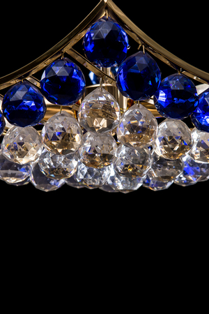 Blue crystal chandelier close up with chains isolated on black blue crystal chandelier close up with chains isolated on black background foto de archivo aloadofball Gallery