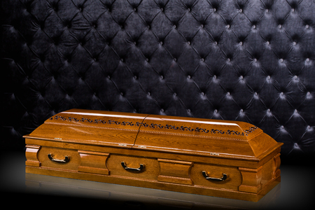 closed wooden brown sarcophagus isolated on gray luxury background. casket, coffin on royal background.