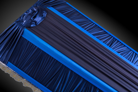 closed blue coffin covered with elegant cloth isolated on gray background. coffin close-up on royal background. Ritual objects for burial. Surrender body dust of the earth. Christian funeral ritual Stock Photo