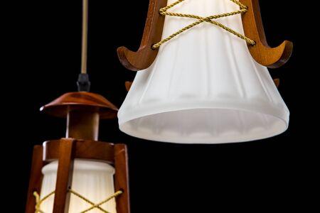 chandelier background: Modern chandelier with flower design for kitchen isolated on black background. Details of chandelier