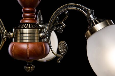 Classic Chandelier isolated on black background. Chandelier lamp for the living room interior. Close-up