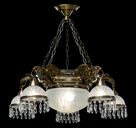 Classic old Chandelier isolated on black background. Chandelier lamp for the living room interior. Stock Photo