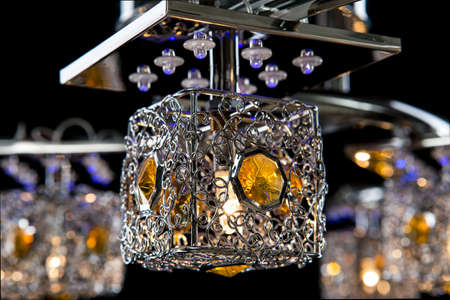 Modern chandelier isolated on black