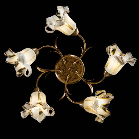 Delicate chandelier of flower lamps isolated on black Stock Photo